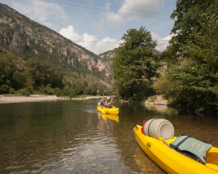 Mary and Joseph arriving at Hautriviere whilst canoeing on the Tarn between St. Enimie and La Malene, Tarn, France